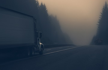 Truck Driving on a foggy highway at Ontario Canada